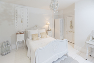White, luxury home showcase bedroom with chandelier - CAIF20150