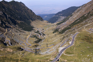 High angle view of winding roads against mountains - CAVF17858
