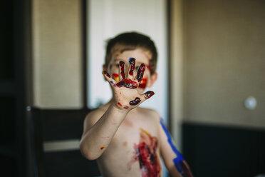 Shirtless boy showing messy hand - CAVF18149