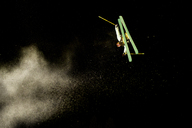 Skier performing stunt against sky at night - CAVF19241