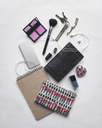 Overhead view of personal accessories on white background - CAVF19541