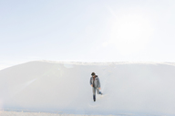 Man walking at White Sands National Monument against sky on sunny day - CAVF20753