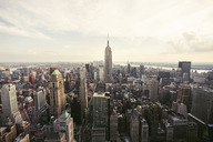 Empire State Building amidst cityscape against sky - CAVF21224