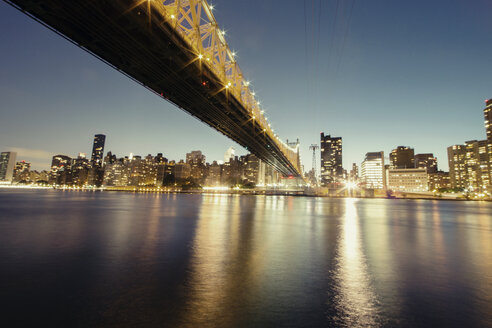Illuminated Queensboro Bridge and skyline at dusk - CAVF21239