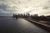 Brooklyn Bridge and city skyline against cloudy sky - CAVF21242