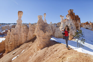 Female hiker hiking on mountain at Bryce Canyon National Park during sunny day - CAVF22574