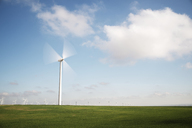 Wind turbine in motion on field against sky - CAVF22637