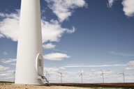 Wind turbines on field against blue sky - CAVF22655