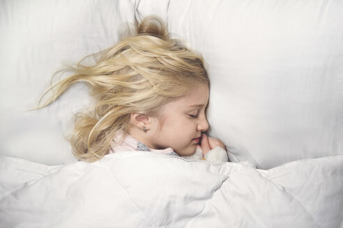 High angle view of cute girl sleeping on bed at home - CAVF22955