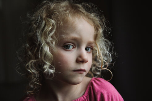 Close-up portrait of girl against black background - CAVF23150
