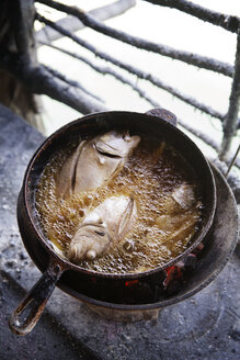 High angle view of fish frying in pan - CAVF23357