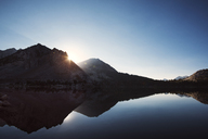 Scenic view of lake with reflection of mountains against clear sky - CAVF23666