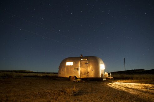Motor home against sky during night - CAVF23762