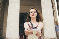 Beautiful woman taking selfie against building - CAVF24035