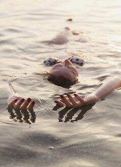 Seductive young woman swimming in lake - CAVF24041