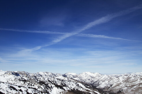 Scenic view of snow covered Wasatch Mountain range against sky - CAVF24095