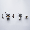 Overhead view of coffee making procedure against white background - CAVF24218