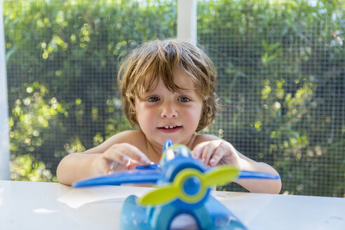 Cute child playing with toy at home - CAVF24562