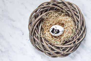 Painted Easter egg in nest with straw - SBDF03486