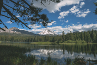 Idyllic view of lake against mountains and cloudy sky at Lassen Volcanic National Park - CAVF24717