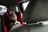 Boy sleeping while sitting in car - CAVF24807