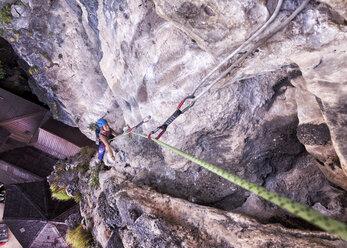 Thailand, Krabi, Tonsai beach, woman climbing in rock wall - ALRF01014