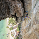 Thailand, Krabi, Tonsai beach, woman climbing in rock wall - ALRF01032