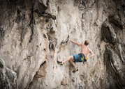 Thailand, Krabi, Lao Liang, barechested climber in rock wall - ALRF01035