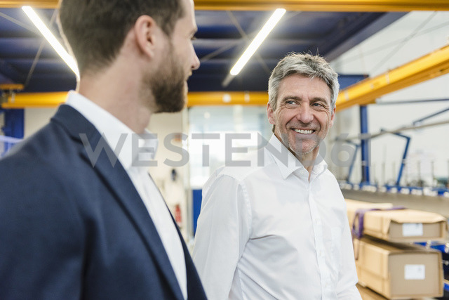 Businessmen during meeting in production hall - DIGF03535