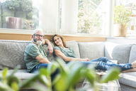 Mature couple relaxing on couch at home - MOEF00956