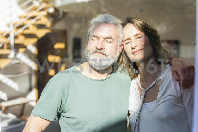 Mature couple with closed eyes enjoying the sunshine - MOEF00977