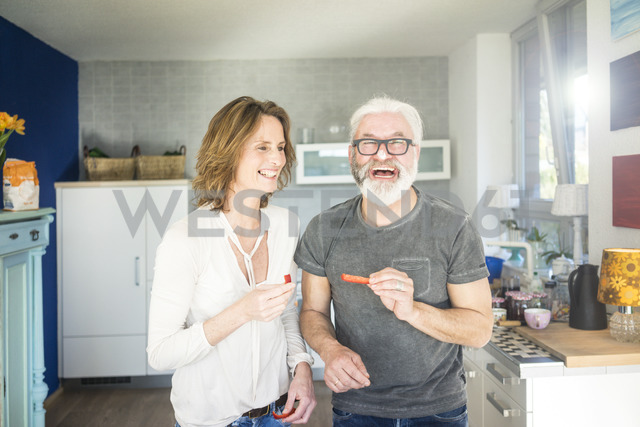 Laughing mature couple in kitchen at home - MOEF00986