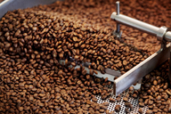 Close-up of coffee beans in roaster - CAVF25159