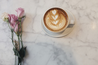 High angle view of coffee with flowers on table at cafe - CAVF25513