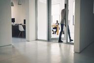 Businesswoman entering in office - CAVF25618