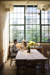Couple relaxing and drinking coffee in restaurant - CAVF26332