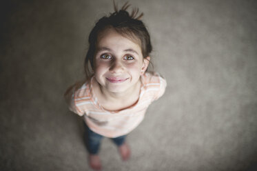 High angle portrait of smiling girl standing at home - CAVF26416