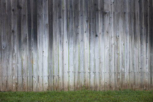 Wooden fence on grassy field - CAVF26542