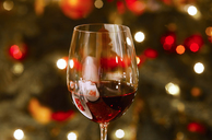 Glass of red wine at Christmas time, close-up - JTF00956