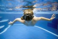 Portrait of girl swimming in pool - CAVF26784