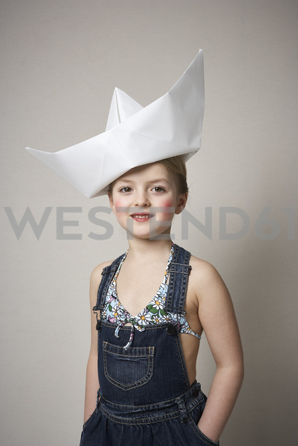 Portrait of little girl with big paper boat on her head - FSF01000
