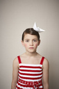 Portrait of little girl with paper boat on her head - FSF01003