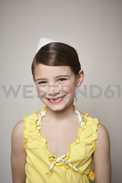 Portrait of grinning little girl with paper hat on her head - FSF01006