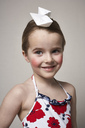Portrait of smiling little girl with two paper boats on her head - FSF01012