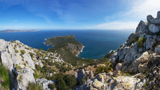 Spain, Balearic Islands, Mallorca, Peninsula Alcudia, View to Cap de Pinar, hiker between rocks - WWF04215