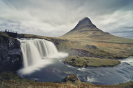 Iceland, Kirkjufellsfoss waterfall and Kirkjufell in the background - STCF00542