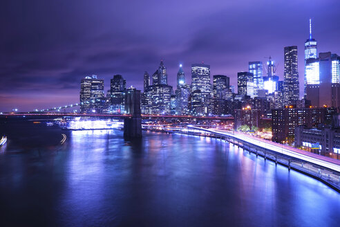 Brooklyn Bridge over river against illuminated city - CAVF27211