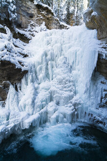 Idyllic view of frozen waterfall over mountain - CAVF27313