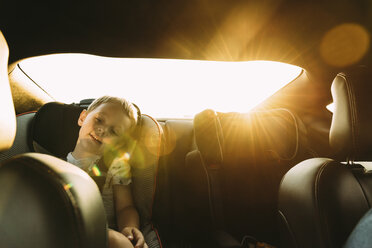 Boy relaxing while sitting in car - CAVF27514