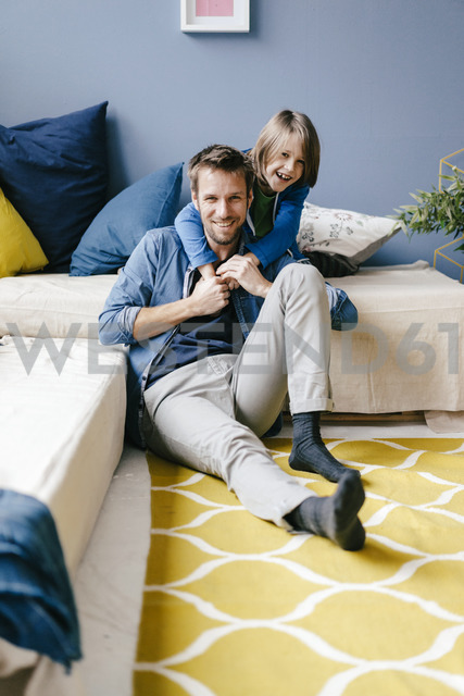 Portrait of happy father and son at home - KNSF03597